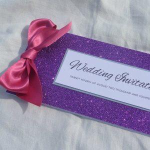 Glitterati cheque book invitation in purple - ribbon could be silver