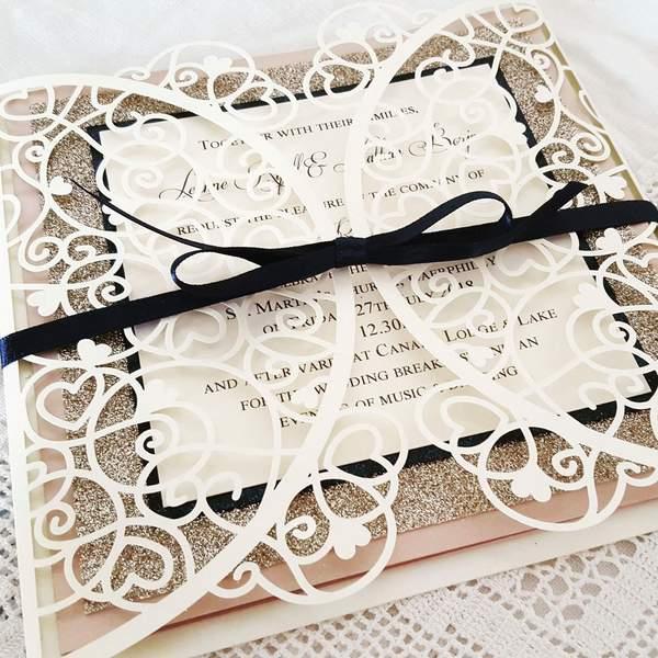 intricate laser cut wedding invitation
