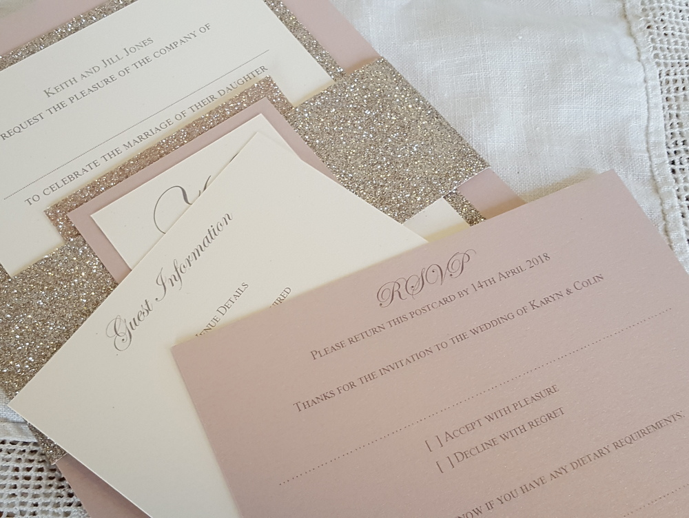 Blush pink & champagne glitter bellyband invitation with guest information and reply cards