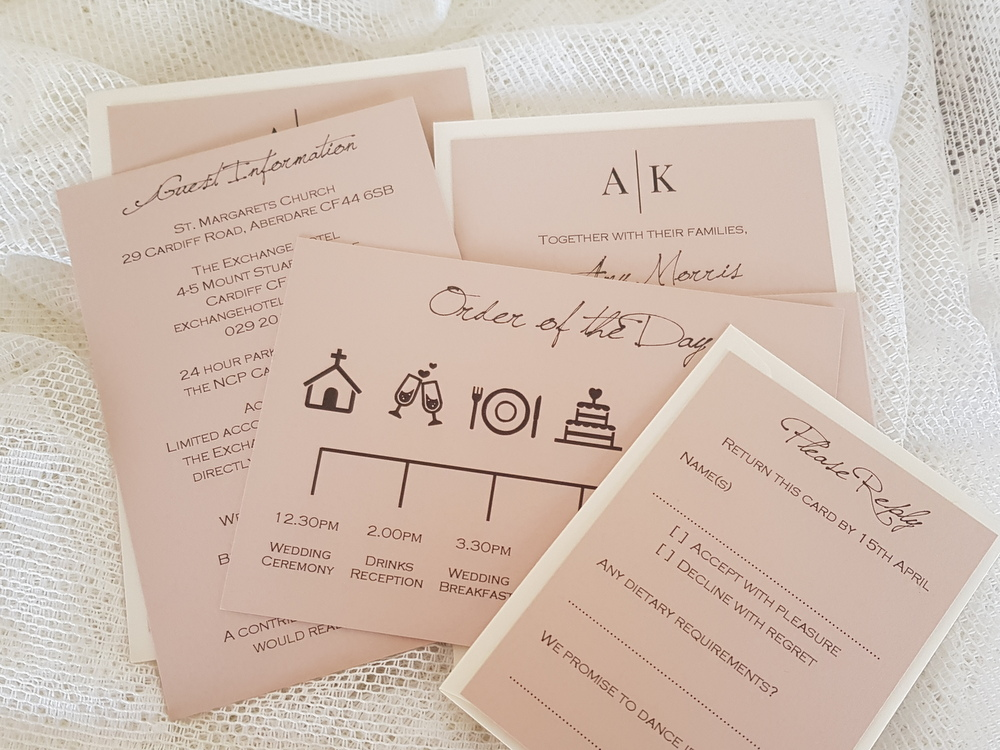Blush and ivory wedding invitation with order of the day card included