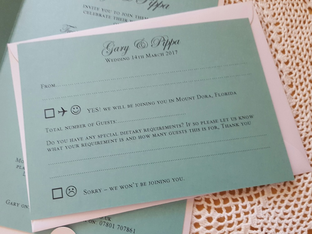 Teal blue reply card with envelope for a wedding abroad