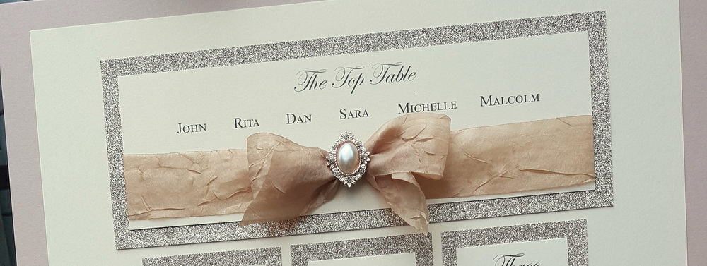 wedding top table plan with silk bow and pearls