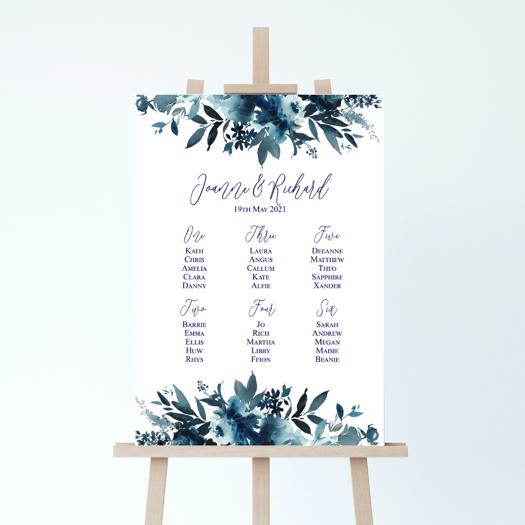 Wedding table plan with a bold navy blue floral design at the corners