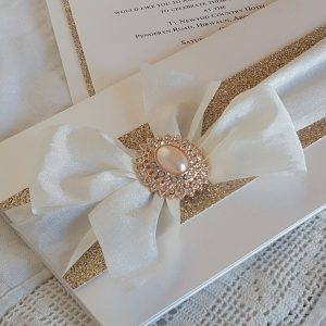 bows and bling ivory and rose gold glitter wedding invitation