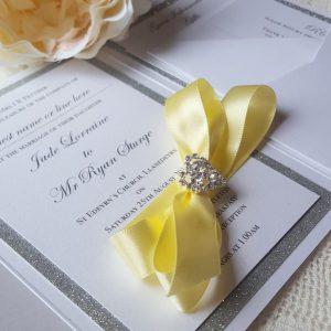 bows and bling lemon and silver invitation
