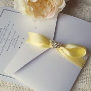 white pocketfold with lemon yellow ribbon bow