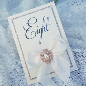 wedding table number with silk bow and rose gold pearl