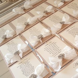 table plan with silk ribbon, glitter and diamante