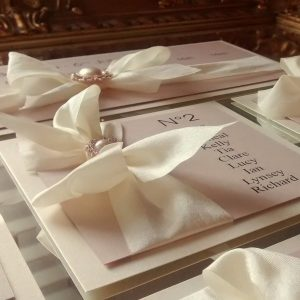 blush table plan with silk bows and pearls