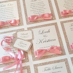 champagne glitter and pink table plan with tags