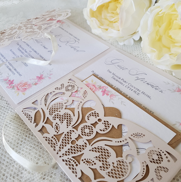 coral wedding invitations with laser cut detail and kraft accents