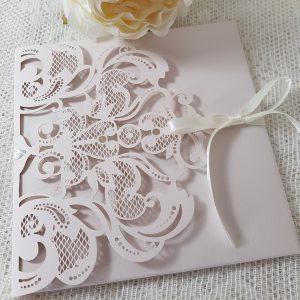 pale pink laser cut pocketfold invitation