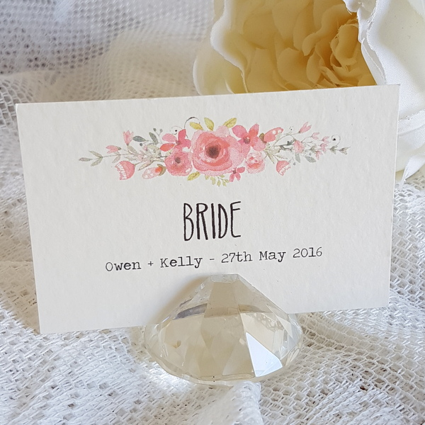 flat wedding place card in a crystal holder with pink flowers