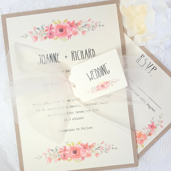 pretty floral wedding invitation with tulle bow and tag