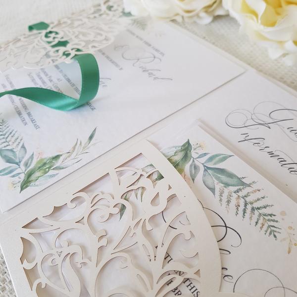 laser cut pocketfold wedding invitation with greenery print
