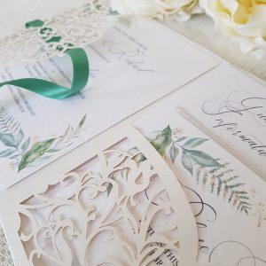 laser cut pocketfold invitations with pretty greenery print