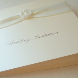 folded invitation pearl buckle