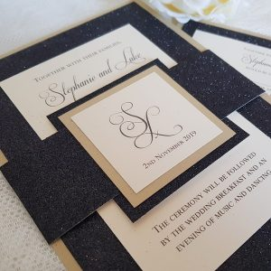 black and gold glitter bellyband invitations