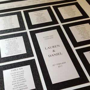 striking black glitter wedding table plan