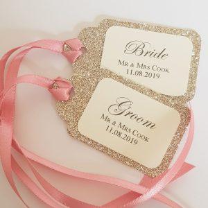 glitterati champagne and pink place tags