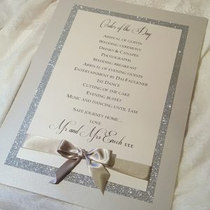 silver glitter order of the day board