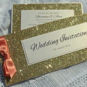 gold and coral cheque book invitation