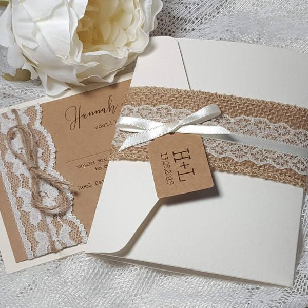 Rustic hessian and lace wedding invitations with kraft card and twine