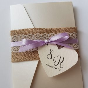 wedding invitation with hessian lace and lilac ribbon