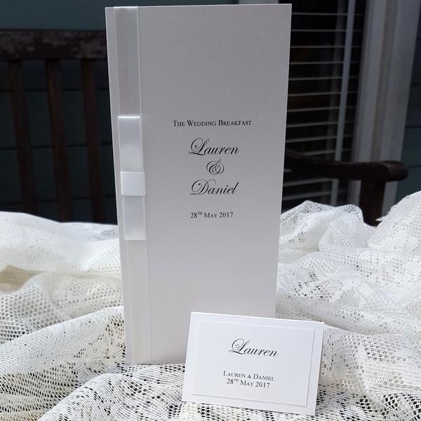 ivory dior bow wedding menu card