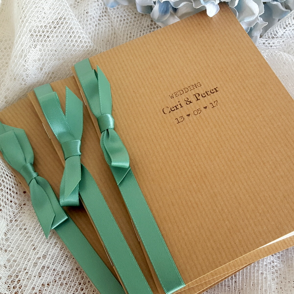 kraft order of service with green ribbon