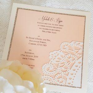 peach and champagne doily invitation