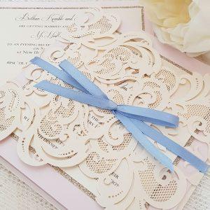 pink and blue wedding invitation