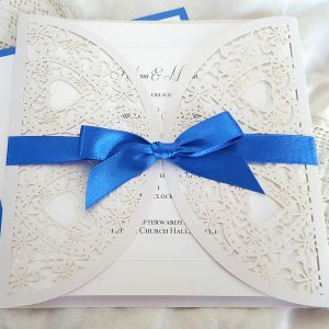 white and blue wedding invitation with hearts