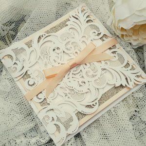 white, champagne and peach laser cut wedding invitation