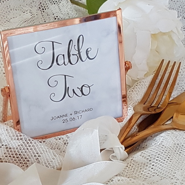 marble table number with copper frame