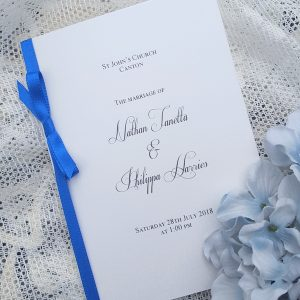 white and royal blue wedding order of service