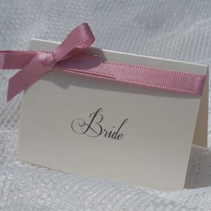 classic ivory place card with dusky pink ribbon