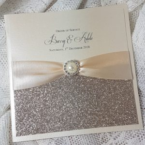 champagne glitter and pearl embellishment order of service