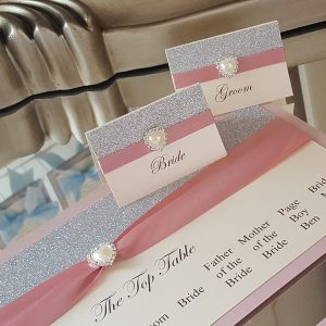 silver glitter and dusky pink wedding able plan and place cards
