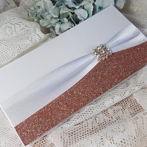 pocketfold wedding invitation with rose gold glitter and diamante brooch