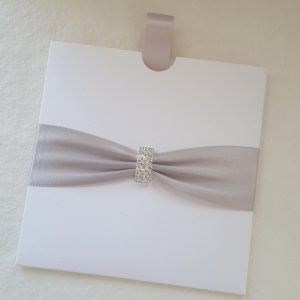 simple pull out wedding invitation with silver ribbon and diamante buckle