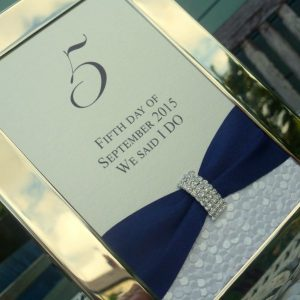sequin sparkle table number in frame