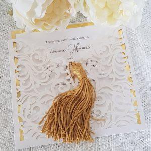 laser cut wallet invitation with gold tassel