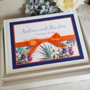 blue and orange wedding guest book