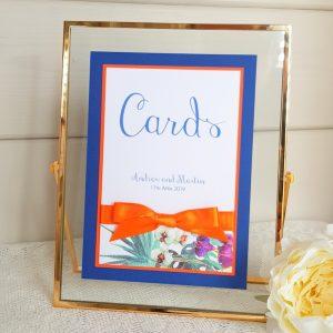 blue and orange wedding cards sign