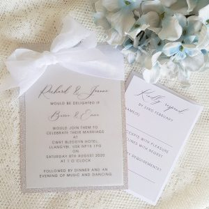 vellum and glitter invitation with white silk ribbon