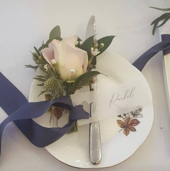 vellum place tag with calligraphy and navy silk ribbon