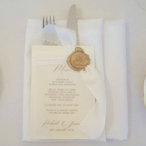 vellum and parchment menu with silk ribbon and wax seal