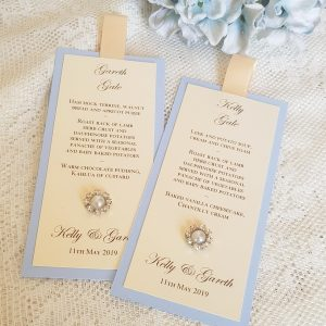 blue and ivory wedding menus with pearls