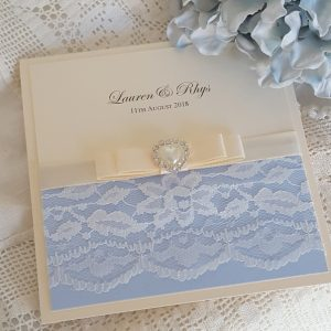 blue and ivory lace wedding invitation with pearls